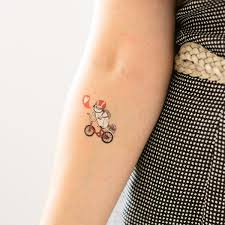 tattly designy temporary tattoos u2014 pug on bike by gemma correll