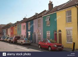 painted houses street with painted terraced houses in pastel colours stock photo