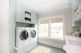 gray and blue laundry room with blue and gray recycled glass tile