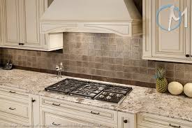 bianco antico granite with white cabinets bianco antico is the perfect match to the tile backsplash as well