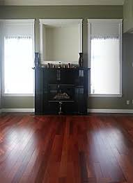 furniture and curtain colours that match a cherry hardwood floor