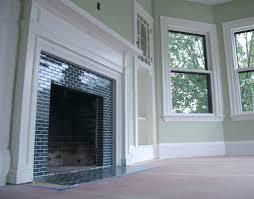 Fireplace Tile Design Ideas by These Small Black Subway Tiles Surrounding The Fireplace Look