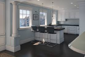 a breakfast bar separates the kitchen from the living and dining room areas jpg