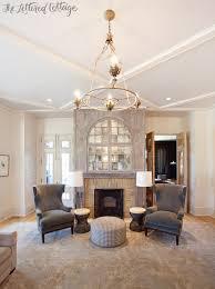 beautiful rug living room fireplace wingback chairs