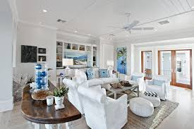 tropical beach living room with gray carpet and ceiling fan using
