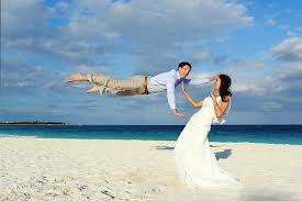 trash the dress beach riviera maya jumping groom trash the dress