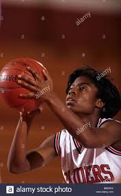 female high basketball player in action shooting a free