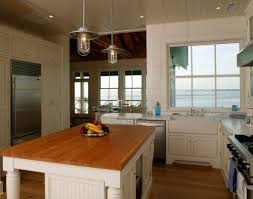 kitchen island with wood top distinctive black antler rustic pendant lighting over kitchen