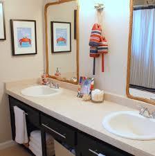 bathroom remodel bathroom black vanity white counter white