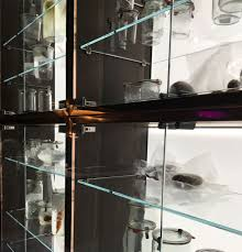 the beauty and function of solid glass doors and frameless cabinet
