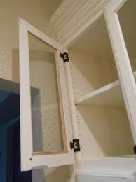 convert wood cabinet doors to glass how install a light in a cabinet and also make your own glass doors