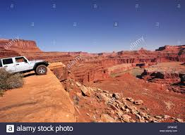 moab jeep trails jeep standing at brim above colorado river white rim drive white