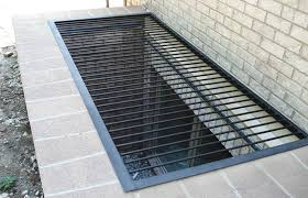 iron egress window well grate cover shown with gated section