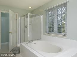 traditional master bathroom with limestone tile floors u0026 jet