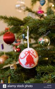 christmas decorations hanging on a real nordmann fir abies stock