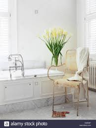 modern shabby chic white bathroom with marble white tulips and