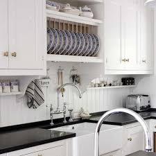 beadboard backsplash in kitchen kvanum crisp white kitchen with black quartz countertops