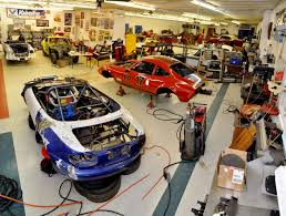 miata dealership working on the miata an fp opel and doing a roll cage for a 240z