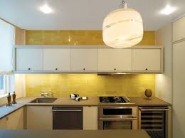 Yellow And White Kitchen Cabinets Interior Glass Kitchen Backsplash Combined With Blue Led Light