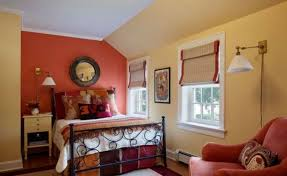 orange bedroom curtains unique round mirror on orange wall paint color combination for