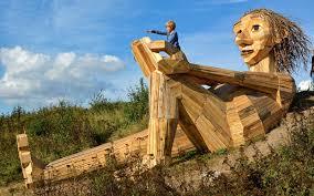 artist hides wooden sculptures across denmark s forests