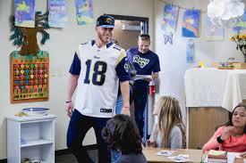 rams visit three elementary schools in holidays for heroes effort