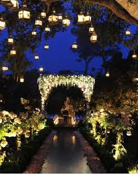 enchanted garden night wedding with hanging lanterns algún día
