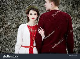couple red dress pink sweater stock photo 541435183