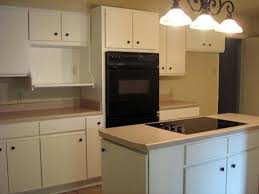 How To Update Old Kitchen Cabinets This Person Took Old 80 U0027s Kitchen Cabinets And Painted Them White