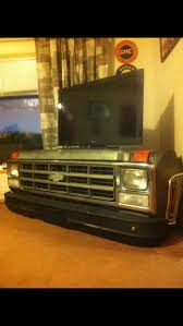 auto raising tv cabinet chevy truck tv stand garage ideas man cave workshop organization