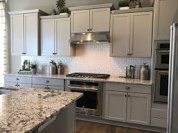 bianco antico granite with white cabinets kitchen merillat portrait shale cabinets with bianco antico granite