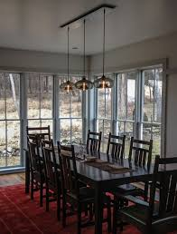 photo wonderful dining room lights above table how to light a