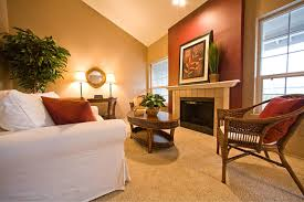 warm living room nuanced using beige wall accents paint feat