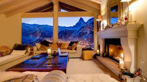 other cozy livingroom overlooking ski resort mountains view