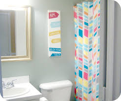 kids bathroom idea with colorful curtain and wall art idea playuna