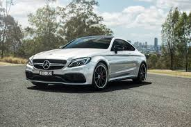 mercedes beamer bmw m4 competition v mercedes amg c63 s coupe road comparison