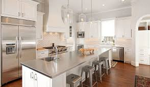 white kitchen island with stainless steel top how to make the most of stainless steel backsplashes