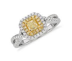 yellow engagement rings yellow diamond radiant cut halo twist ring in 18k white and
