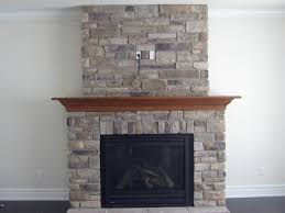 brown brick stone fireplace with wooden mantel for complete modern