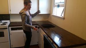 Diy Wooden Kitchen Countertops Applying A Protective Finish To Our Torched Diy Wood Countertop