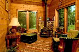 welcoming small hunting room of a wood cabin with low ceiling also