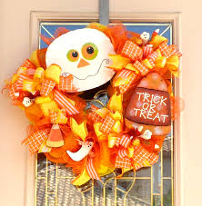 fun halloween wreath with ghost and candy corntrick or treat