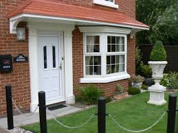 front door awning cottage canopy clarendon canopy exterior beautiful house design with patio door canopy ideas above white door and stylish bay window ideas combined with green front yard i
