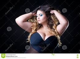young beautiful caucasian plus size model with big breast in black