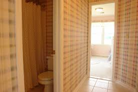 bathroom jack and jill bathrooms with checked wallpaper and white