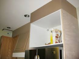 how to build storage above kitchen cabinets closing the space above the kitchen cabinets remodelando