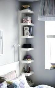 small bedroom storage ideas small bedroom storage bed surrounded by shelving units small space