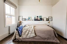 bright cal king headboard in bedroom eclectic with painted brick