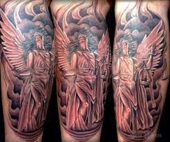 cool mystic designed justice statue tattoo on leg tattoos photos