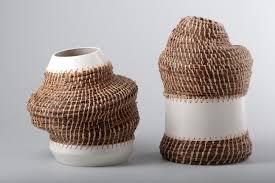 caruma by eneida tavares a series of vases made with pine tree